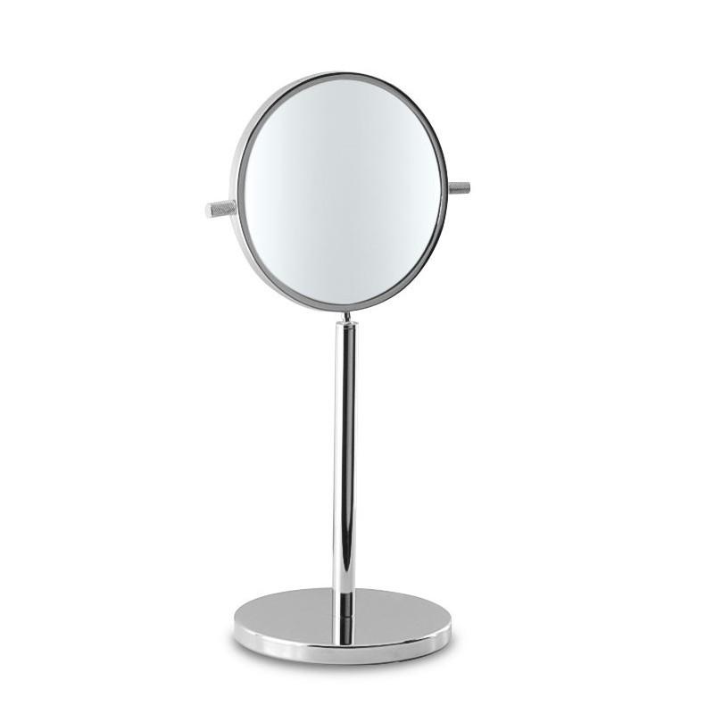 Specchio ingranditore da appoggio estraibile.